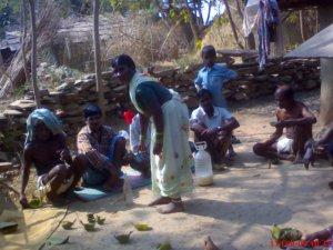 Tribals drinking Liquor as breakfast